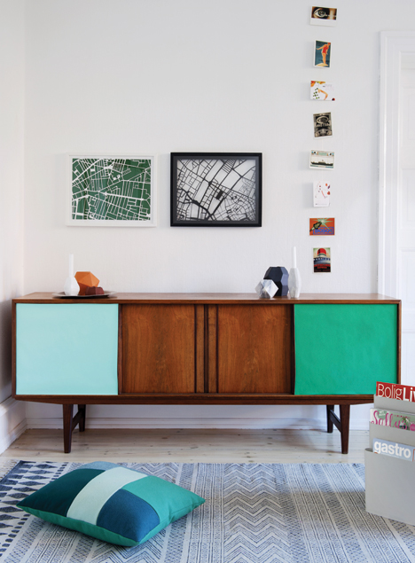 Vintage sideboard with painted sliding doors