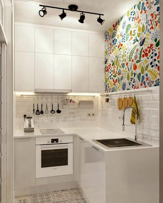 Statement floral wallpaper in a white kitchen