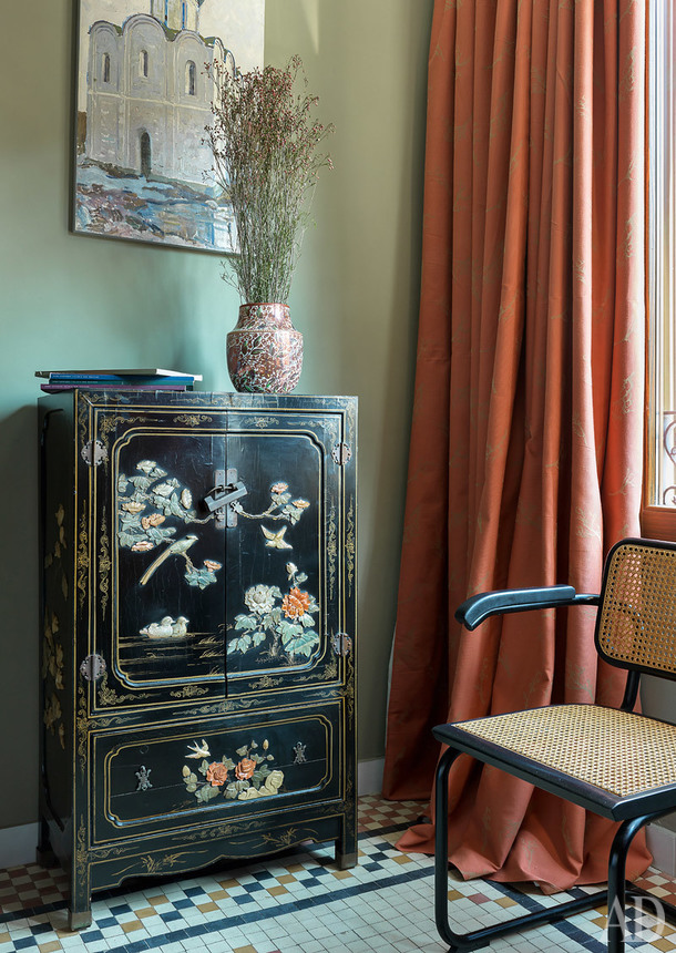 Valencia home tour: antique cupboard meets Russian artwork