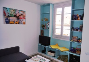 Blue wall-to-wall bookcase