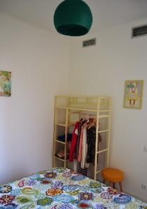 Yellow green bedroom: corner view