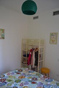 Bedroom corner with storage system