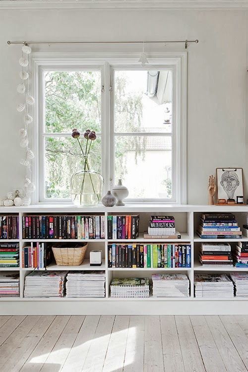 In-built bookshelves under the window