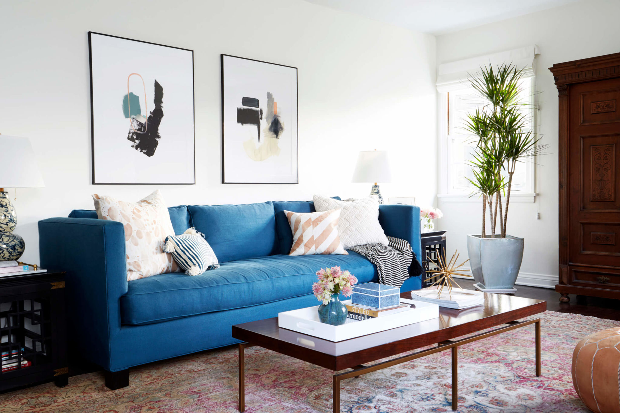 Blue statement sofa against neutrals