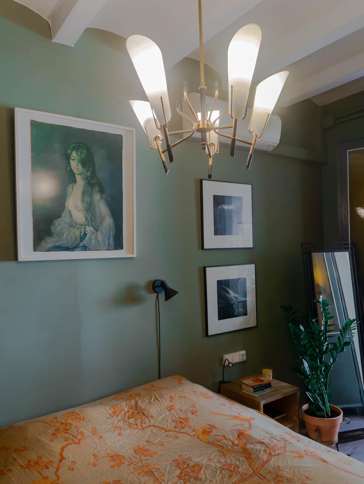 Barcelona home tour: sage green master bedroom with Hermes throw and vintage chandelier