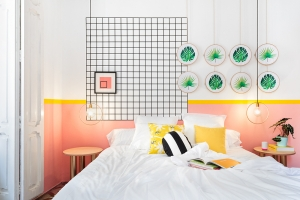 Valencia Lounge Hostel designed by Masquespacio: colour-block pink and white wall