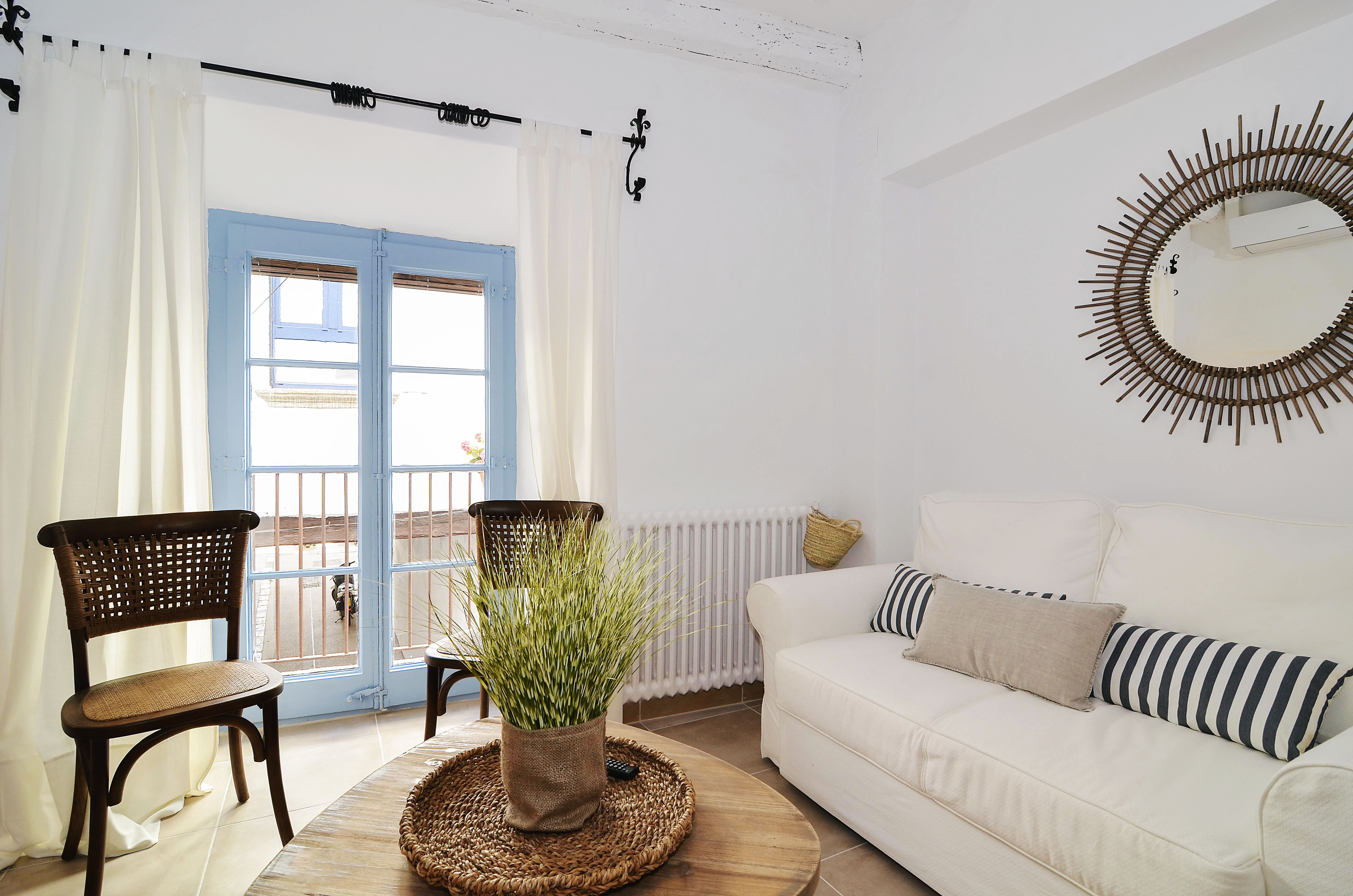 House tour: old fisherman's house in Sitges: sitting room with blue window