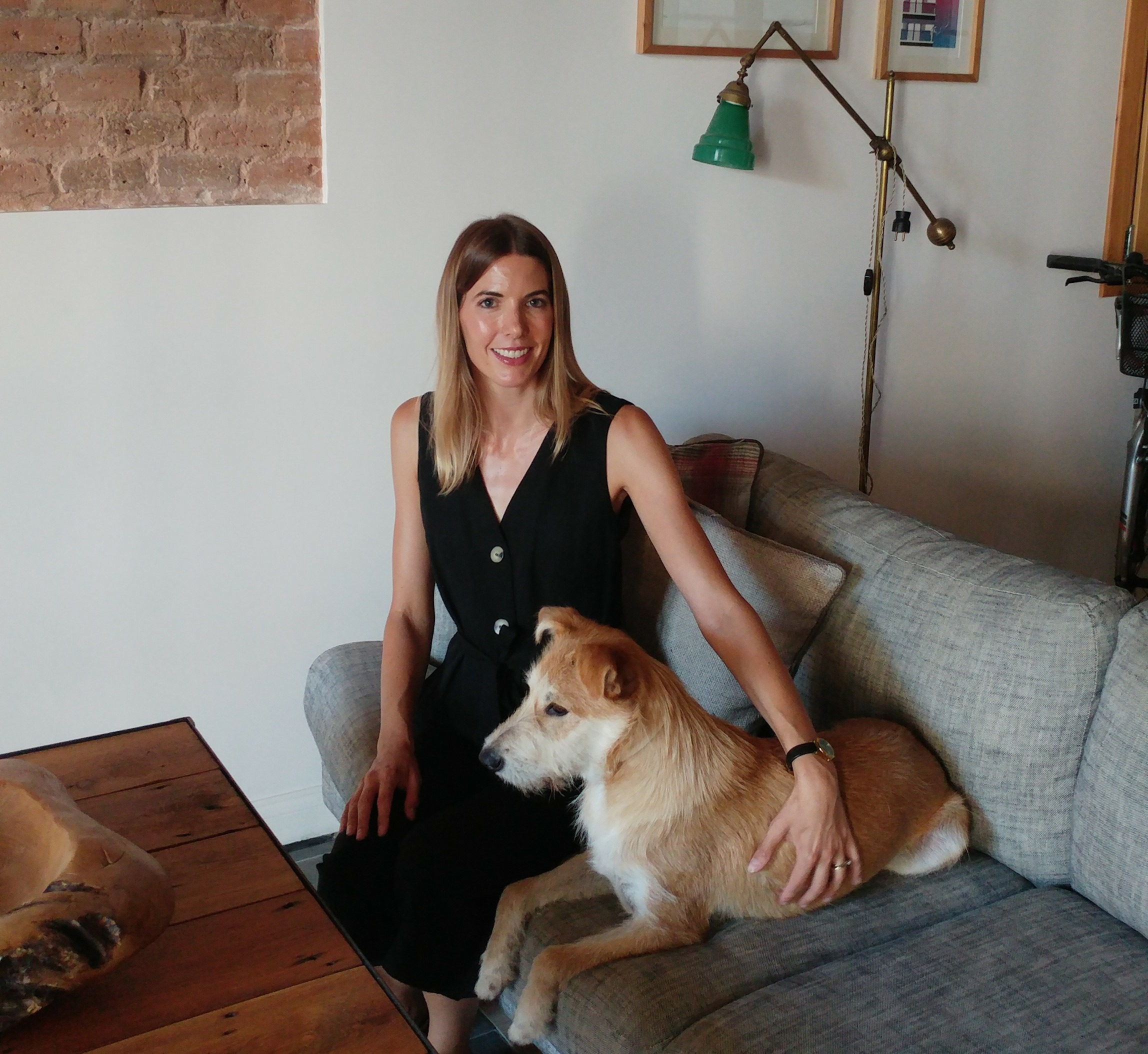 Gemma Askham and her puppy Diego in their Barcelona home