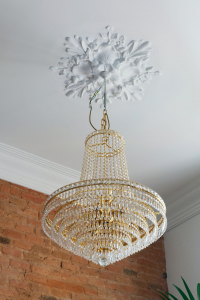 Gemma Barcelona Home Tour chandelier with floral molding