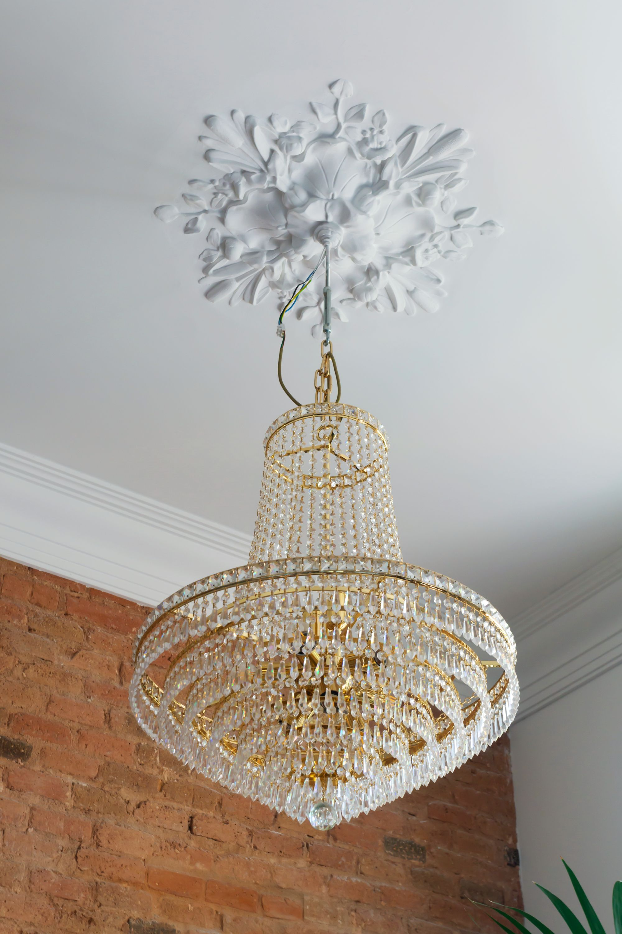 Gemma Barcelona Home Tour chandelier with floral molding