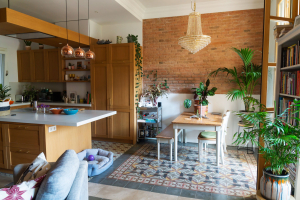 Gemma home tour Barcelona open space with kitchen and dining table with tile floor