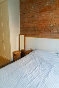 Gemma home tour Barcelona bedroom exposed brick wall