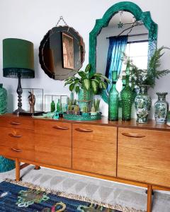 @lorriecos mid-century credenza with green decor