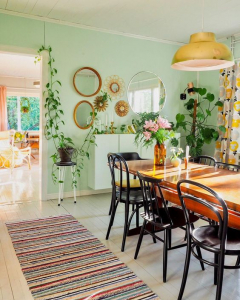 @vintageinteriorxx bohemian vintage home in Finland - green wall in the dining room